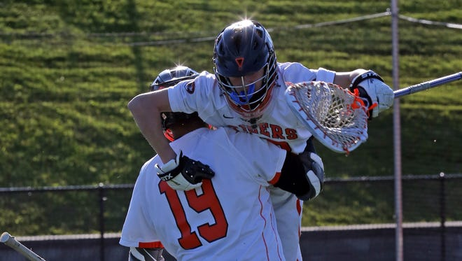 White Plains Omar Tapia (19) celebrates with his teammate after defeating North Rockland 13-12  during boys lacrosse Section 1 Class A opening-round game at White Plains High School on May 16, 2016.