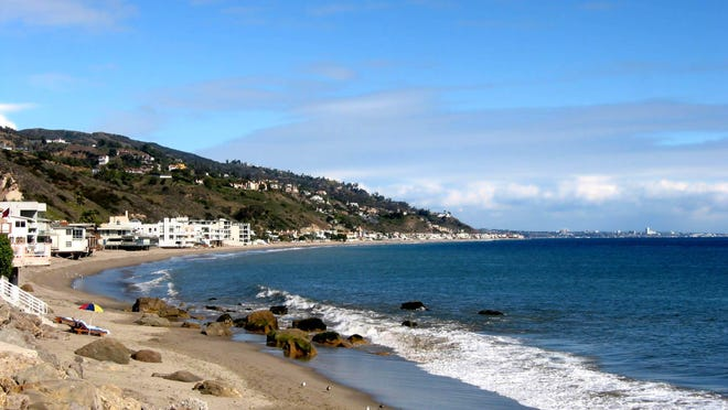Malibu hugs 21 miles of sparkling waves and craggy rocks with narrow to expansive sand.