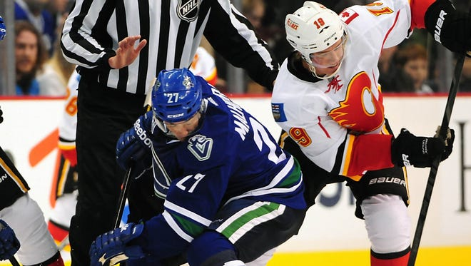 Former Vancouver Canucks center Manny Malhotra (27) was signed by the Carolina Hurricanes in part for his ability to win faceoffs.