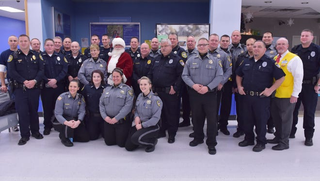 Law enforcement officials who participated in Shop With a Cop this year at Walmart in Mountain Home on Saturday.