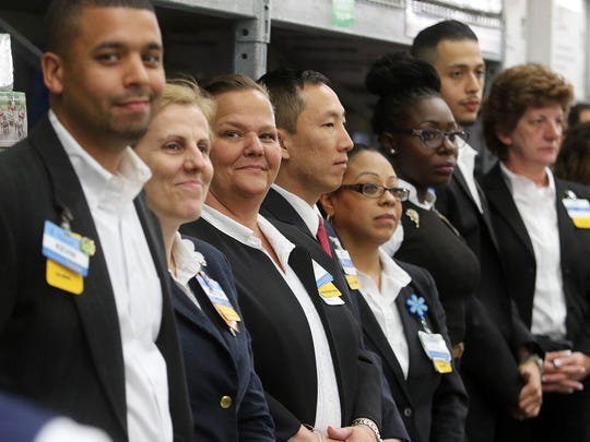 Walmart managers who helped instruct the graduates