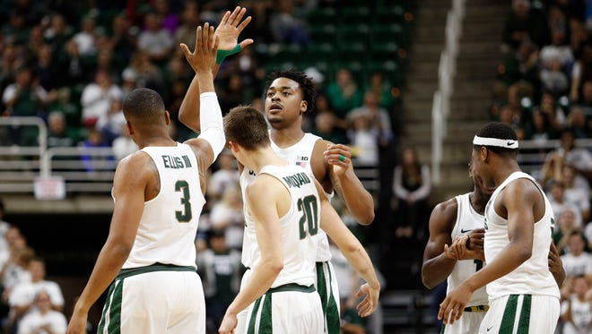Michigan State Spartans forward Nick Ward (44) give a high-five to guard Alvin Ellis III (3) during the second half against the Youngstown State Penguins at Jack Breslin Student Events Center. Spartans win 77-57.