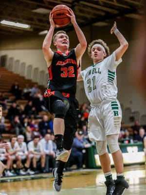 Brighton's Dalton Porth, who scored a team-high 14 points, drives to the basket against Howell's Josh Palo in a game last year.