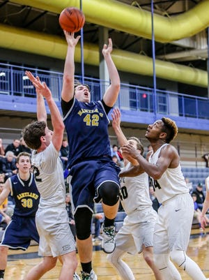 Hartland's Jason Gigliotti (42) had nine points to help the Eagles to a 59-37 win over South Lyon East in a Class A district opener on Monday.
