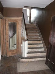 A view of the master staircase and coat closet from