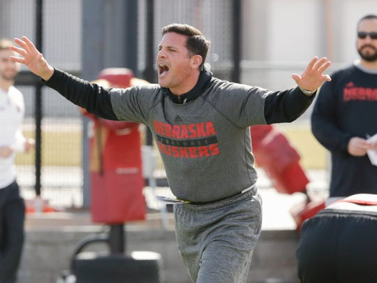 FILE - In this March 4, 2017, file photo, Bob Diaco works with players on the first day of NCAA college football spring practice, in Lincoln, Neb. Diaco is always moving. There's no time to waste for Nebraska's new defensive coordinator. (AP Photo/Nati Harnik, FIle)