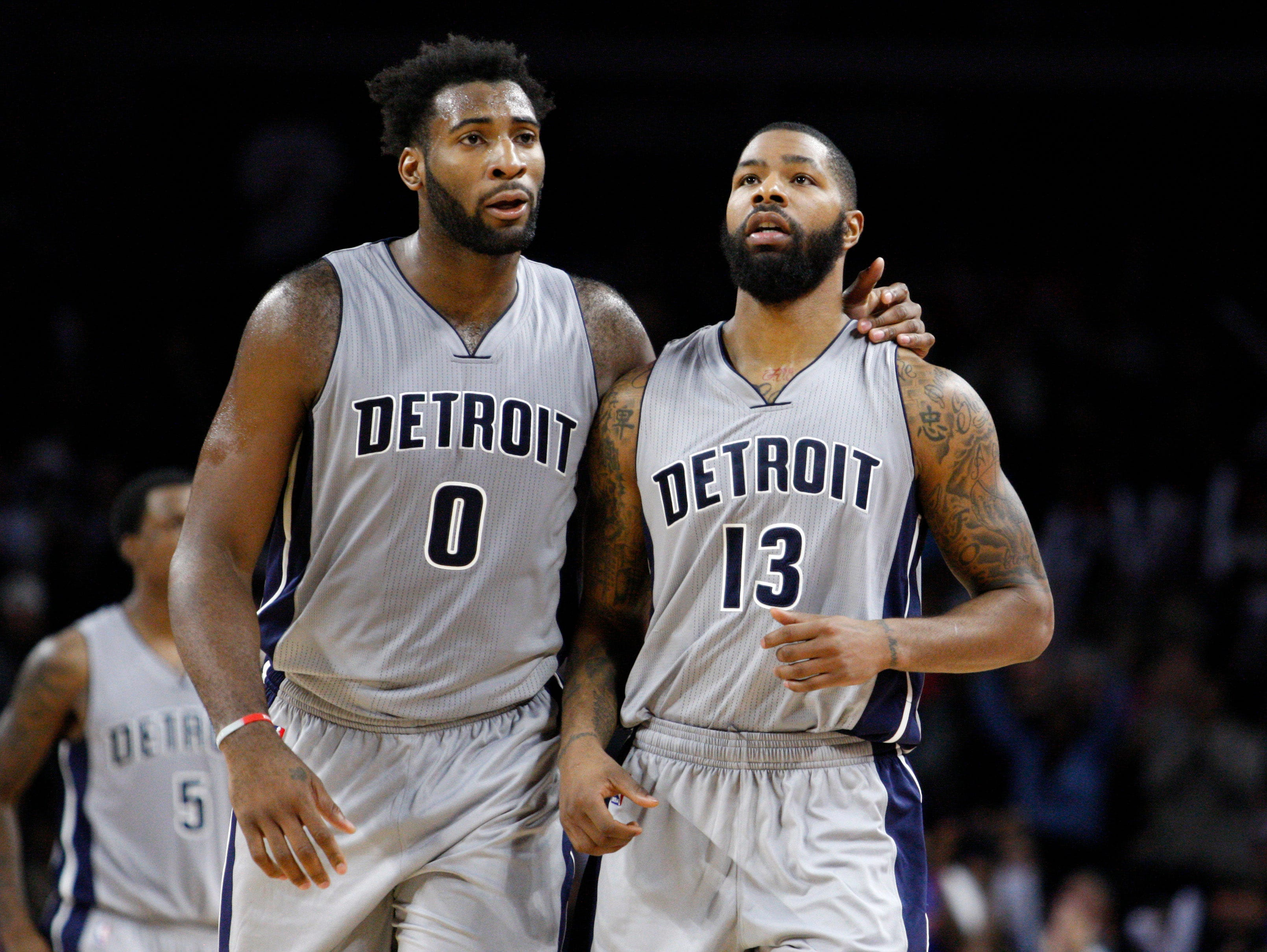 Oct 30, 2015; Auburn Hills, MI, USA; Detroit Pistons center Andre Drummond (0) puts his arm around forward Marcus Morris (13) during the fourth quarter against the Chicago Bulls at The Palace of Auburn Hills. Pistons win in overtime 98-94.