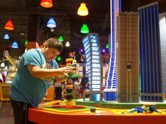 Marcus Grijalva, 8, builds an earthquake-proof building,