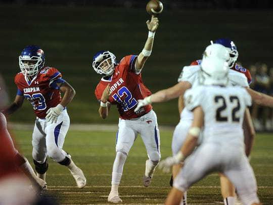 Cooper quarterback Austin Smith (12) throws a pass during the second quarter of the Action Zone Champions Classic on Aug. 26 at Shotwell Stadium.