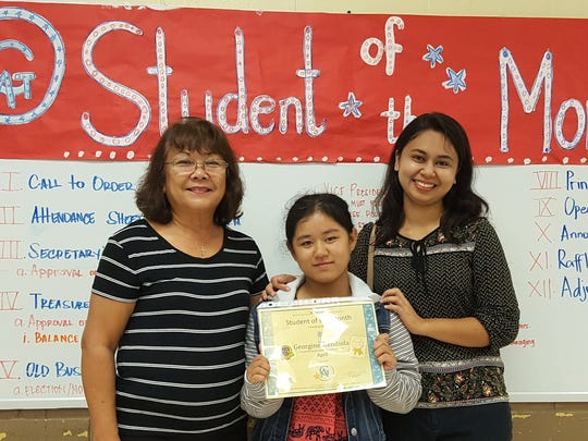 The Guahan Academy Charter School honored its April Student of the Month awardees on May 10, 2018. Pictured from left: Teresita Cruz, Dean of Elementary School Guahan Academy Charter School; Georgine Mendiola and Angelica Gabriel.