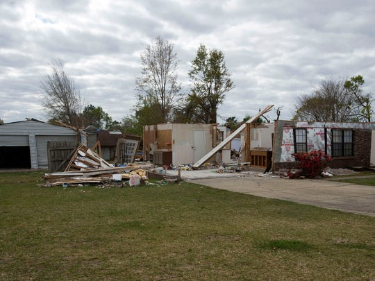 One-month after a tornado struck the Northpointe area, homes damaged by the EF-3 storm are still easy to find.