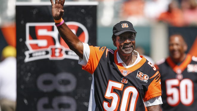 Former Cincinnati Bengals cornerback Ken Riley waves to the crowd during a halftime 50th anniversary ceremony of an NFL football game against the Baltimore Ravens, in Cincinnati, on Sept. 10, 2017. Riley, who was later a head coach and athletic director at his alma mater Florida A&M, died Sunday.
