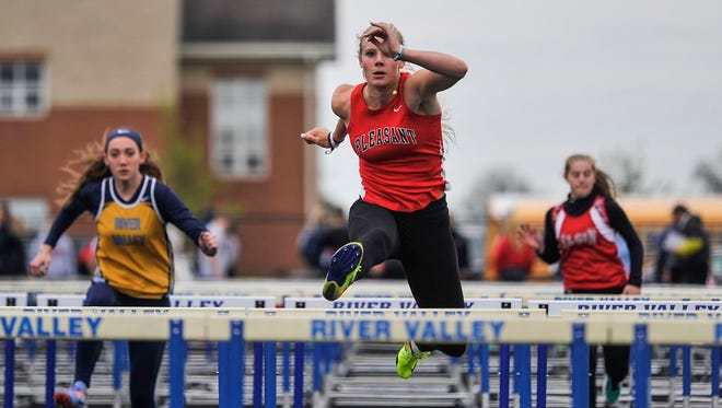 Pleasant senior Lydia DePrey runs to a win the 100 hurdles during the Marion County Track Meet at River Valley this season. She won a pair of of Division III district championships in the 100 hurdles and pole vault over the weekend to qualify for regionals.