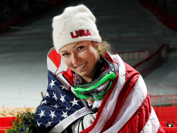 Mikaela Shiffrin (USA) celebrates winning gold in ladies' alpine skiing slalom.