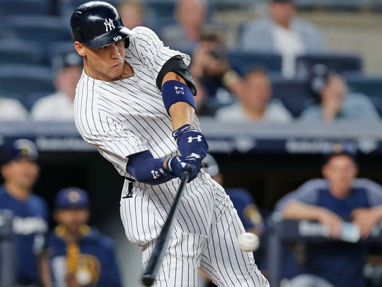 New York Yankees' Aaron Judge hits a fifth-inning solo