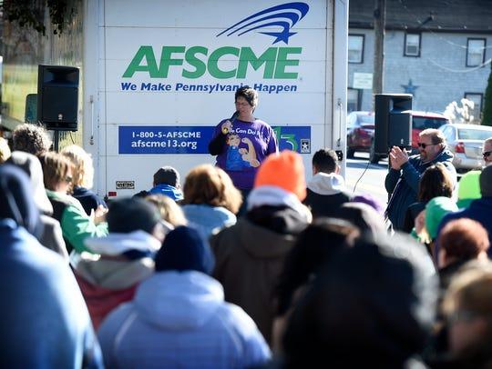 Union president Penny Kleinfelter speaks to strikers and supporters from the back of a truck Friday afternoon during the Cedar Haven Nursing home rally held to mark the four week anniversary of the walk out.