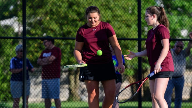 Henderson County's Kally Priest (left) and Isabelle Wright (right) take on Madisonville's Emily Fischels and Emily Shockley during a Second Region Tournament girls doubles semifinal match at the Doc Hosbach Tennis Complex in Henderson, Ky., Tuesday, May 8, 2018.