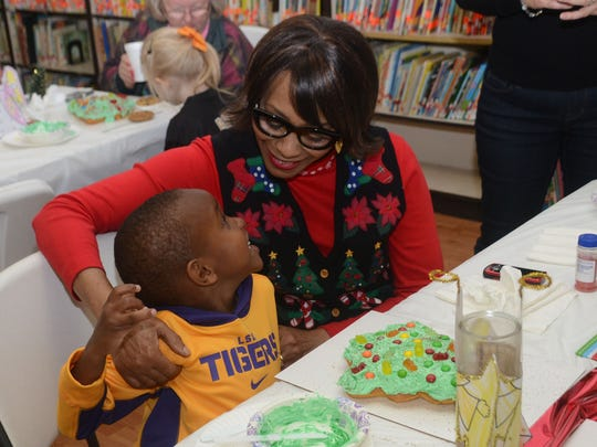 St. Frances Cabrini School pre-kindergartener Jameson Gray and his grandmother Brenda Cooper decorate a Christmas cookie.