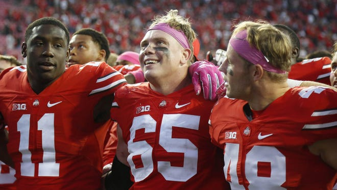 Former walk-on Joe Burger, right, is in his fifth season with the Buckeyes and was awarded a scholarship this season.