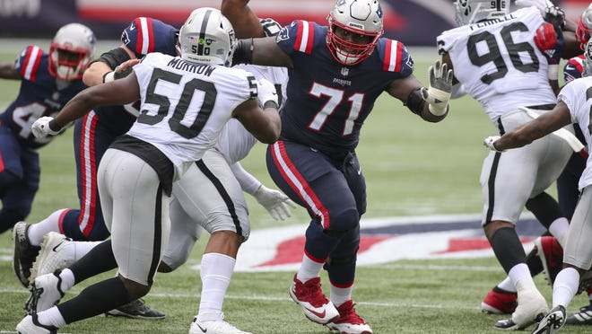 New England offensive lineman Mike Onwenu looks to make a block earlier this season against the Raiders.