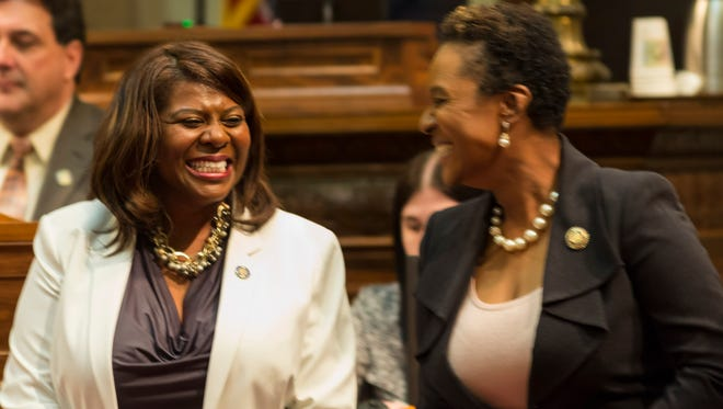 Wisconsin Sens. LaTonya Johnson, left, (D-Milwaukee) and Lena Taylor (D-Milwaukee) smile during the 103rd opening session of the Wisconsin State Senate in Madison, Wis.
