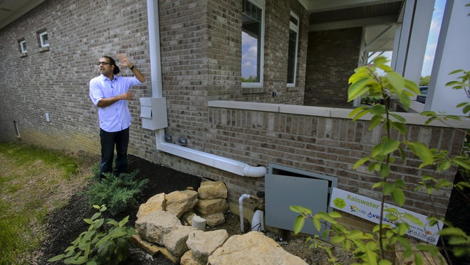 Sy Safi, of GCCM Construction Services, showed in 2013 how rain water is collected from the roof and stored under the front porch of a LEED-certified home in Louisville.