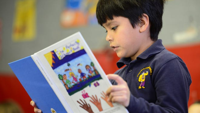 """Jonathan Rosales reads his story from the book. Second grade students at Woodrow Wilson School #5 read """"The Perfectly Different Book,"""" which was self-published by the school highlighting the students' work."""