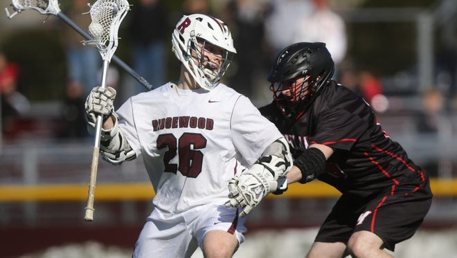 Jack Kiernan of Ridgewood tries to move around Garret Rofheart of Northern Highlands.  Ridgewood went on the beat visiting Northern Highlands, 10-6.  Wednesday, March 29, 2017
