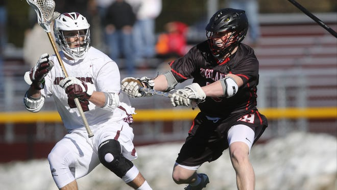Wylie Sherman of Ridgewood controls the ball in front of Jermey Barr of Northern Highlands. Ridgewood went on the beat visiting Northern Highlands, 10-6.  Wednesday, March 29, 2017