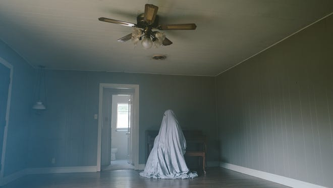 Casey Affleck plays a phantom who watches as life moves on around him in 'A Ghost Story.'