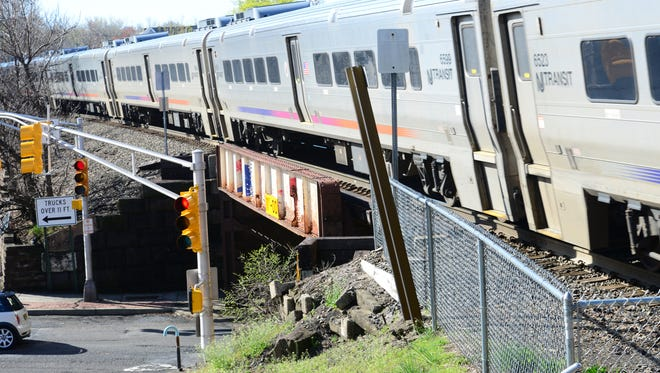 An NJ Transit train approaches the Garfield Train Station at Passiac St in Garfield on Thursday April 26, 2018.
