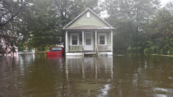 A home sits in high water on W 6th Street after Hurricane Florence brought heavy rains to Washington, N.C.