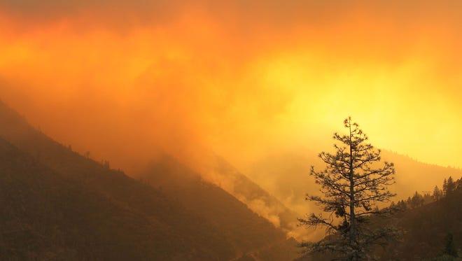 Smoke rises above the Plumas National Forest along Highway 70 on Sunday morning.