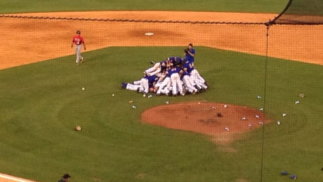 Morehead State's players celebrate with the traditional dogpile after clinching their team's first NCAA regional appearance in 32 years.