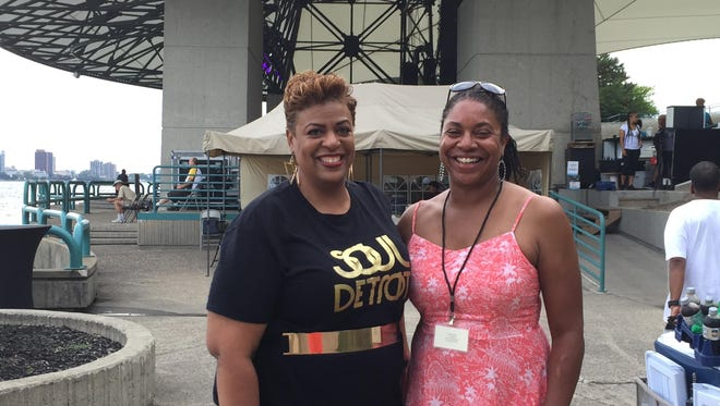 Kim Trent, left, president of the African American 490 Challenge, and Darci McConnell, group vice president, raised over $50,000 at R&B singer Erykah Badu's Aug. 12 concert at Chene Park. The campaign's goal is to get 11,341 unopened Detroit rape kits tested.
