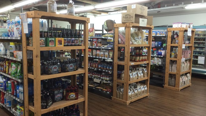 The neighborhood grocery offers a variety of foods, including craft beers and gourmet items and a full-service meat department.