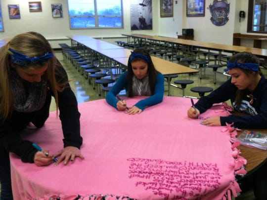 Friends of Paige Kassner sign messages of love and