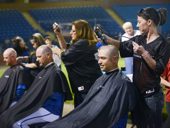 The UNCA baseball team shaved their heads after their