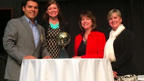 Manny Vasquez (from left) and Beth Pritzl of the Fox Cities Regional Partnership are presented with the IEDC 2015 Best in Show Award for Excellence in Economic Development by JoAnn Crary, chair of IEDC  and Karen Dickson, chair of the IEDC Awards Advisory Committee.
