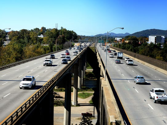 Cars drive down the Captain Jeff Bowen Bridge, or I-240, coming into and out of downtown Asheville in 2015. The bridge also currently acts as the interchange for I-26.