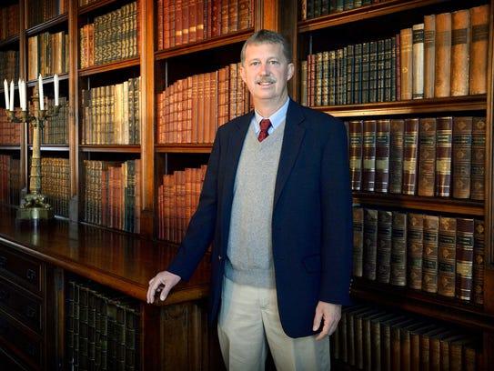 Bill Cecil, great grandson of George Vanderbilt, stands