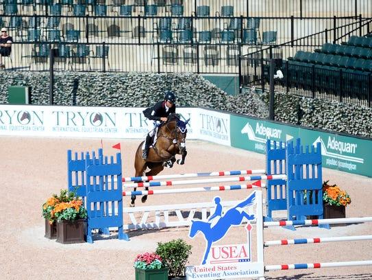 Boyd Martin, of Pennsylvania, leaps over a jump on