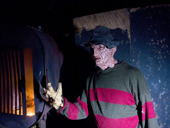 An actor dressed as Freddy Krueger from Nightmare on
