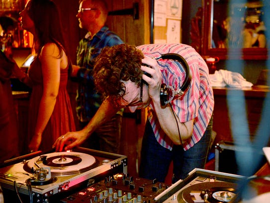 Whitney Shroyer, also known as DJ Dr. Filth, uses headphones