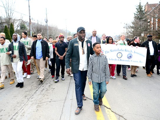 Rev. Brent Edwards walks with a youth from his church,