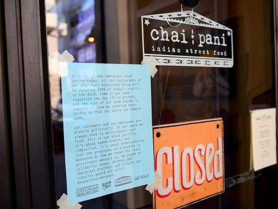 A sign on the door of Chai Pani downtown on Thursday,