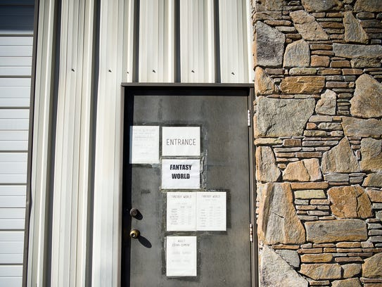 Small, taped-on signs are what little adorn the building