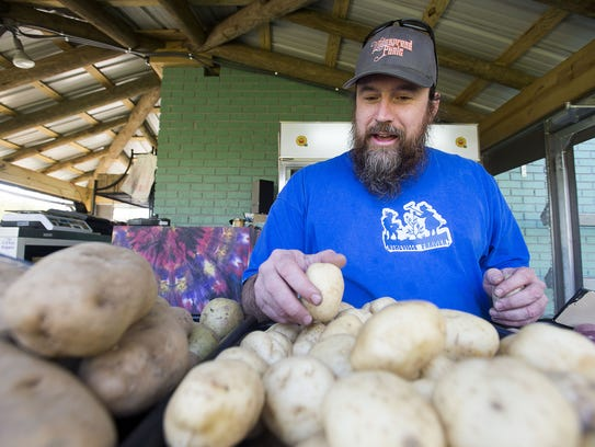 Kendall Huntley of Whispersholler Farms sorts through