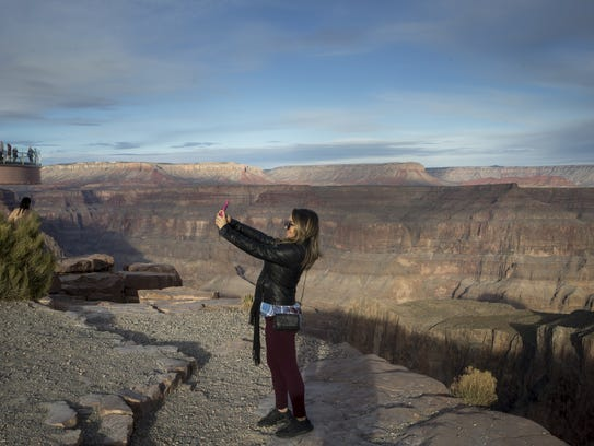 A visitor takes a selfie at Eagle Point, January 16,
