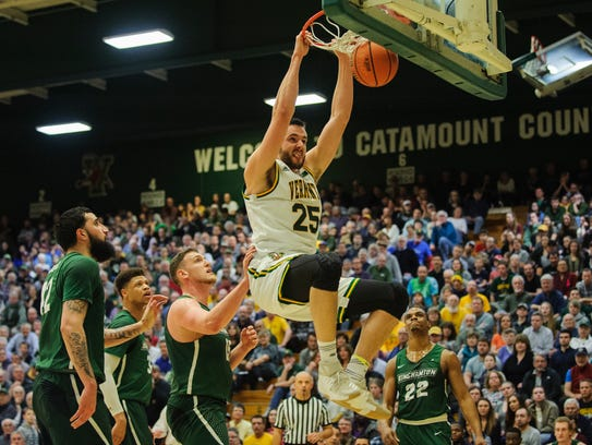 Vermont's Drew Urquhart (25) Dunks the ball during the men's basketball game between the Binghamton Bearcats and the Vermont Catamounts at Patrick Gym on Wednesday night February 21, 2018 in Burlington.